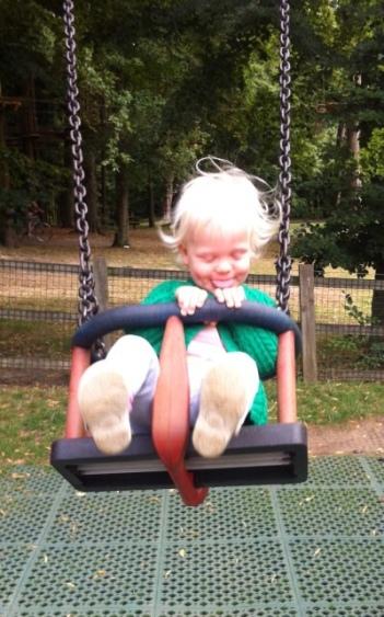 Grace loves the swings!